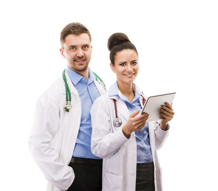 Happy medical team of doctors, man and woman, isolated over white background photo