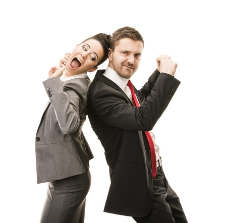Young smiling business woman and business man isolated over white background  Crazy and funny posing in studio