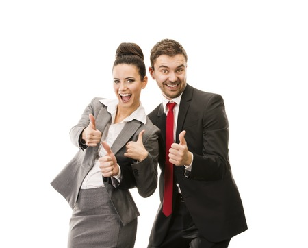 Young smiling business woman and business man isolated over white background  Crazy and funny posing in studio  photo