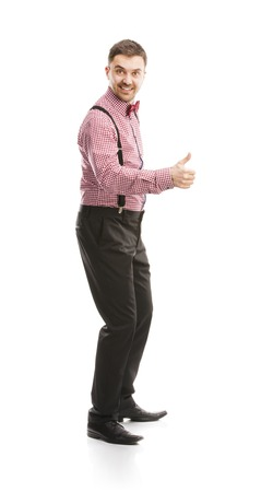 jazzbow: Funny business man is posing in studio with bow tie and braces