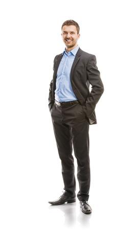 成功するビジネス スーツを着た男が白い背景の全身肖像画で分離されたスタジオでポーズをとってください。