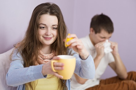 Sick woman and man have cold, flu and high fever  Stock Photo - 26536925