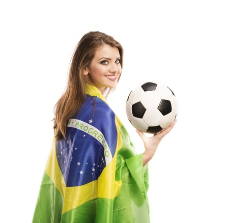 Beautiful female fan with brazilian flag holding a soccer ball isolated on white background photo