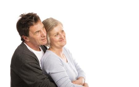 happy couple white background: Studio portrait of happy seniors couple hugging  Isolated on white background
