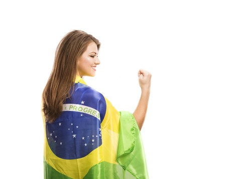 Beautiful female sports fan with brazilian flag isolated on white background photo