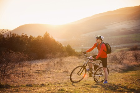 Mountain biker is ridding bike in beautiful nature  photo