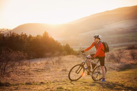 Mountain biker is ridding bike in beautiful nature  photo