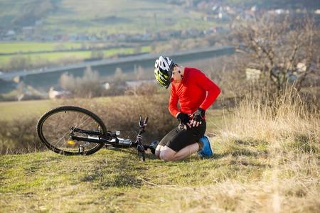 mountain biker: Mountain biker is having bike accident outdoor
