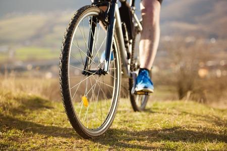 mountain biker: Mountain biker is ridding bike outdoor