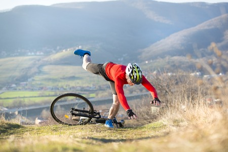 crash helmet: Mountain biker is having cycling accident in nature