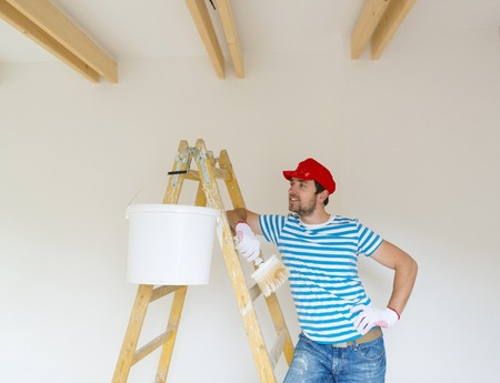 Man painting wall in new house photo
