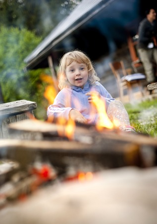 Cute little girl at barbecue  photo