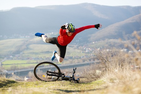 Mountain biker is having accident