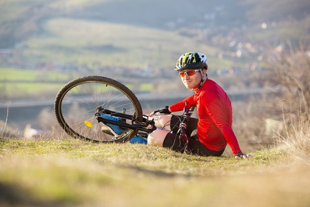 Mountain biker is having cycling accident in nature  photo