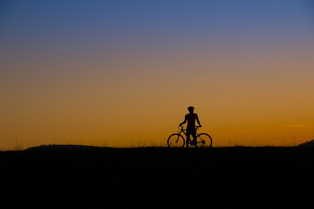 Mountain bike cyclist is ridding outdoor  photo