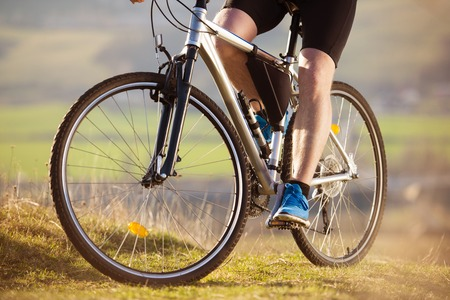 Detail of cyclist ridding mountain bike outdoor photo