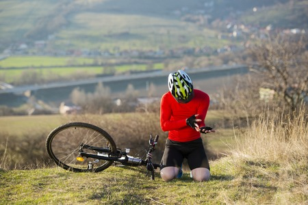 Cyclist having a ridding accident on mountain bike photo