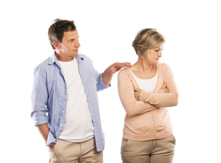 stubborn: Studio shot of angry senior couple having an argument, isolated on white background  Marriage in crisis