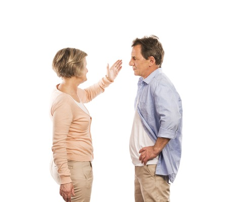 Studio shot of angry senior couple having an argument, isolated on white background  Marriage in crisis  photo