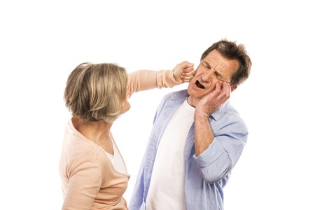 disagreeing: Studio shot of angry senior couple having an argument, isolated on white background  Marriage in crisis