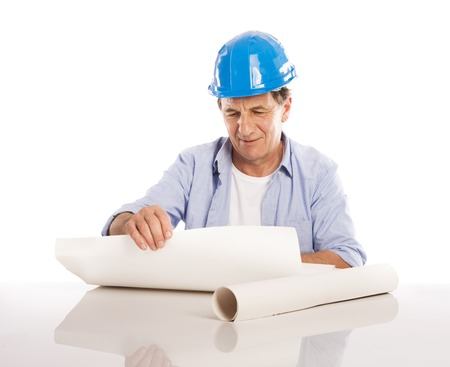 Portrait Of Happy Senior Engineer Holding Plans Isolated Over White Background photo