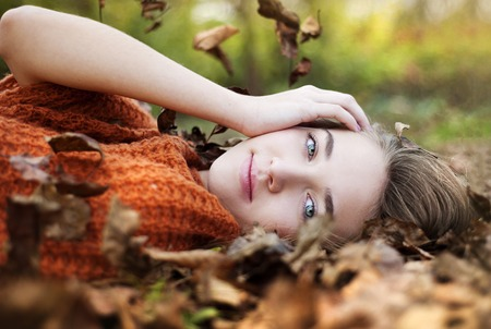 Outdoor portrait of beautiful girl in autumn forest photo
