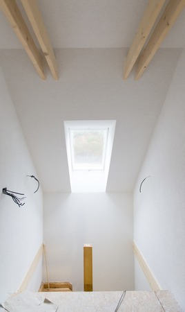 Empty unfinished room with white walls in a new constructed house photo