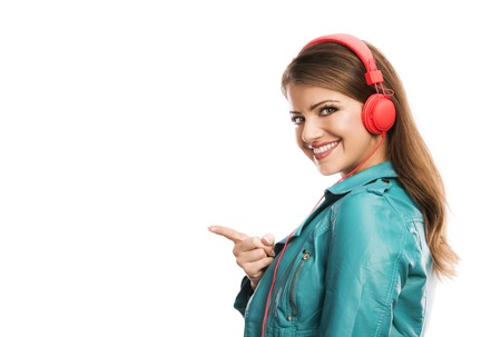 Attractive girl with headphones on white background photo
