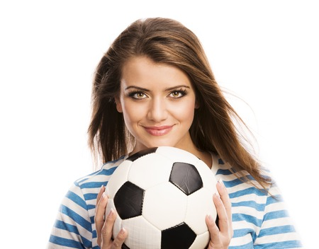 Beautiful woman with soccer ball isolated on white background photo