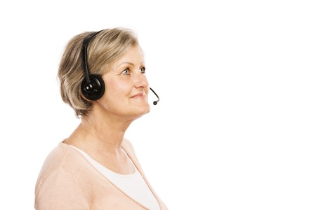 Happy senior woman wearing headset, isolated on white background photo