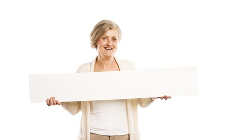 Portrait of happy senior woman with blank advertising board or copy space, isolated on white photo