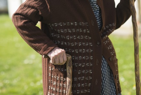 Detail of old woman holding crutch  Stock Photo - 27501670