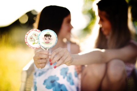 lollypop: Two girls with lollypop