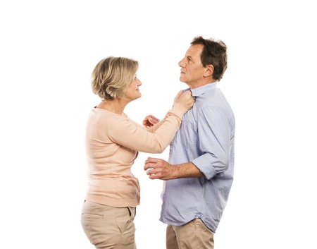 couple fight: Studio shot of angry senior couple having an argument, isolated on white background  Marriage in crisis