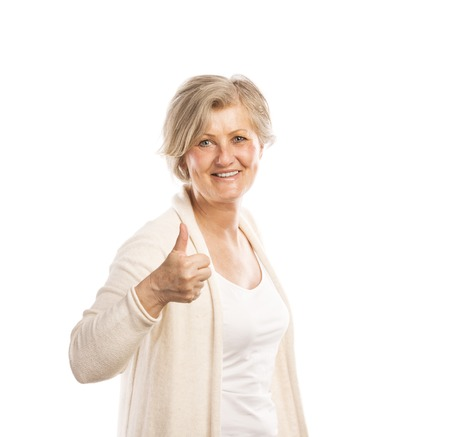Portrait of a happy senior womanwith thumbs up isolated on white background photo