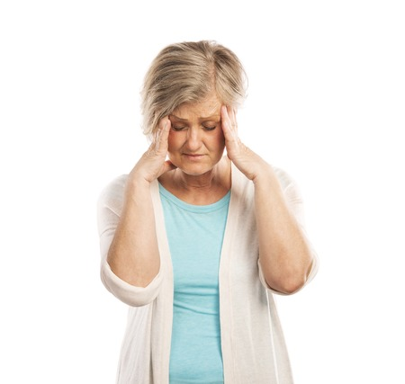 Senior woman has headache, isolated on white background photo