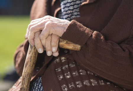 Detail of very old woman s hands holding walking stick Stock Photo - 27476962