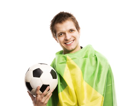 Brazilian soccer fan holding ball and flag of Brazil, isolated on white background photo
