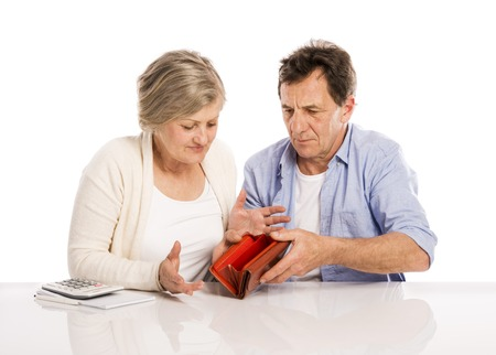 financial issues: Senior couple with empty wallet discussing financial issues, isolated on white background