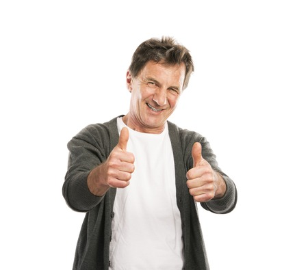 Portrait of a happy senior man with thumbs up isolated on white background photo