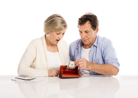 Senior couple with empty wallet discussing financial issues, isolated on white background photo