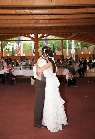 Bride and groom dancing at the wedding reception photo
