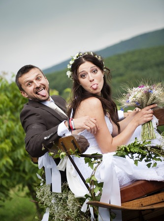 Beautiful bride and groom at country style wedding photo