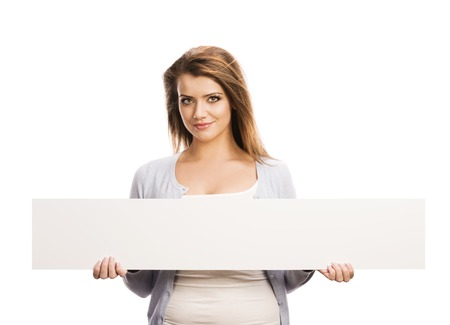 advertising board: Portrait of young happy woman with blank advertising board or copy space, isolated on white Stock Photo