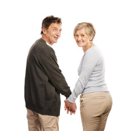 happy older couple: Studio portrait of happy seniors couple holding hands  Isolated on white background