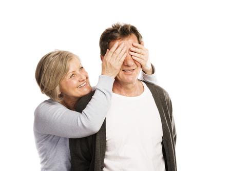 happy couple white background: Studio portrait of happy seniors couple having fun  Isolated on white background