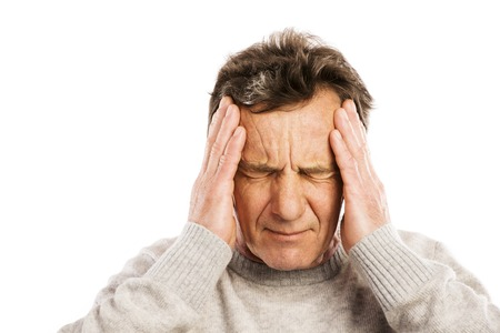 Senior man has headache, isolated on white background photo