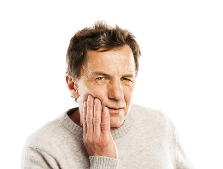 Senior man has toothache, isolated on white background photo