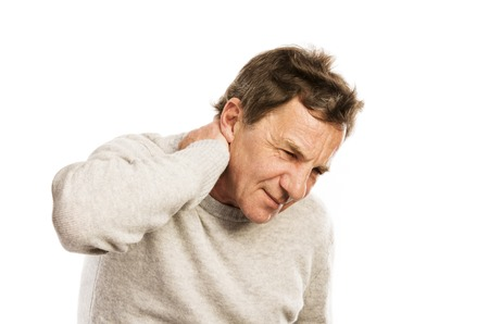 senior man on a neck pain: Senior man suffering from neck pain, isolated on white background Stock Photo