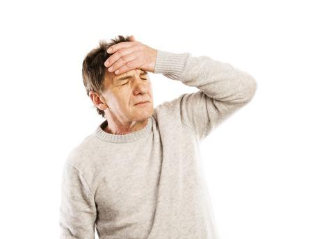 Senior man has headache, isolated on white background photo